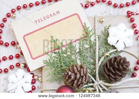 Christmas present and the vintage telegram on a wooden background