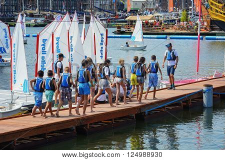 AMSTERDAM, THE NEDERLANDS, AUGUST 20, 2015: Kids are learning to sail at SAIL Amsterdam 2015, the largest free public sail event in the world.