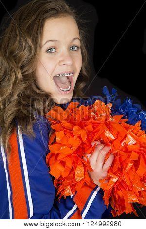 Teen cheerleader cheering excited mouth open braces