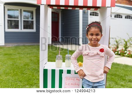 Portrait Of Girl Running Homemade Lemonade Stand