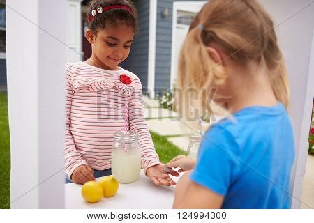 Two Girls Running Homemade Lemonade Stand