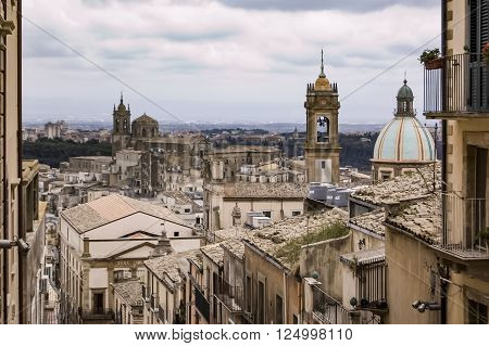 Tourists visit the monumental staircase of Caltagirone with its decorated majolica