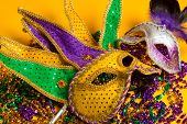 A festive colorful group of mardi gras or carnivale mask on a yellow background. Venetian masks. poster