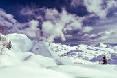 Winter panorama with snow covered slopes and dramatic sky. Komna, Slovenia. poster