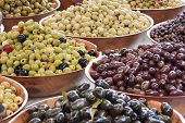 Different coloured olives and red kidney beans poster
