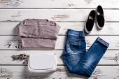Jeans with sweatshirt and shoes. Young woman's outfit on showcase. Simple autumn clothes with handbag. Lady's clothing for spring. poster