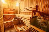 Finnish wooden modern sauna interior. Empty sauna with nobody in. Wooden sauna room. Interior of sauna steam wooden room. Spa and relax, healthcare complex. poster