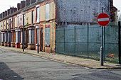 A street of boarded up derelict houses awaiting regeneration in Liverpool UK poster