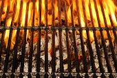Overhead View Of Empty BBQ Hot Fire Grill And Burning Charcoal Briquettes With Bright Flames. Outdoor Scene. Concept for Summer Party Or Picnic Or Cookout. Isolated Black Background. Close Up poster