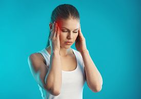 Sad female suffering from stress and pain in temples. Concept of migraine problem and treatment.
