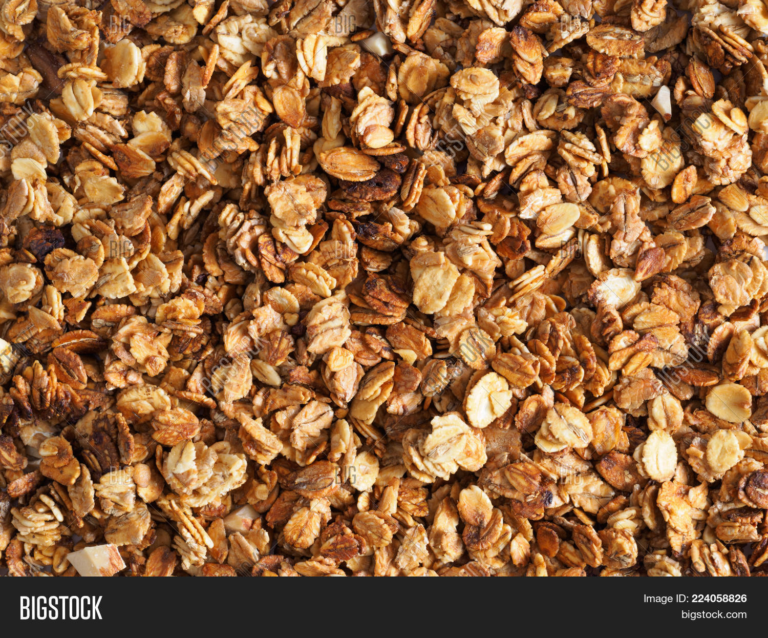Organic homemade Granola Cereal with oats and almond. Texture oatmeal granola or muesli as background