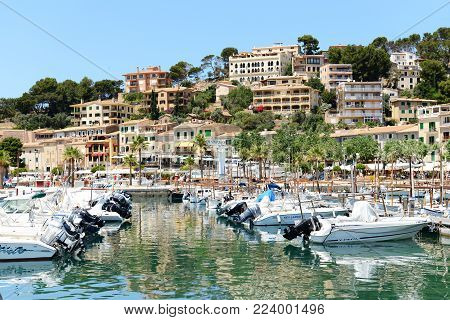 MALLORCA, SPAIN - JUNE 2: The marina and tourists enjoiying their vacation in Port de Soller on June 2, 2015 in Mallorca, Spain. Up to 60 mln tourists is expected to visit Spain in year 2015.