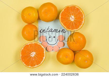 Sticker with the word vitamin . Background yellow, vitamin C, citrus