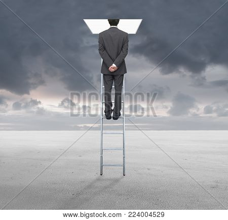 Young businessman on a ladder watching a hole in the clouds