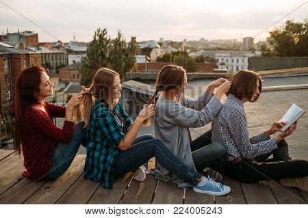 Bff support friendship care. Girls braid each other hair. Teamwork concept
