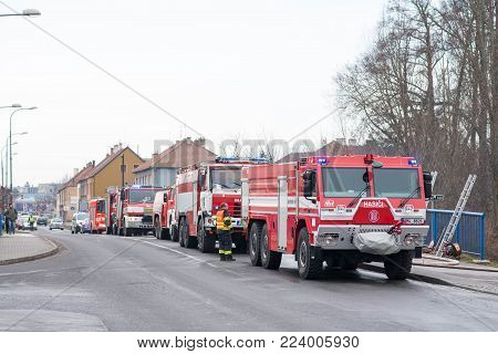 Prostejov Czech Rep 28Th January - Firemen On A Ladder By A Roof Fighting With Fire In Prefabricated