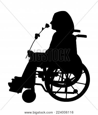 Disabled person in wheelchair smelling rose and waiting for someone to come