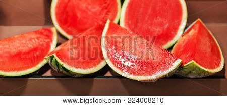 Watermelon background. Organic Ripe red cut in a half and whole  watermelon at  market. Harvesting concept.