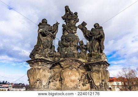 Statue of Madonna and St. Bernard at Charles bridge in Prague, Czech Republic. Architecture and landmark of Praha.