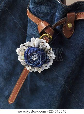 Amazing handmade denim brooch as an original accessory for a stylish women's bag