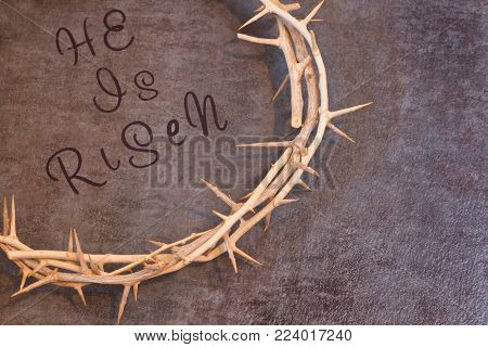 Easter He is Risen Quote surrounded by a Crown of Thorns on a textured background with room for text