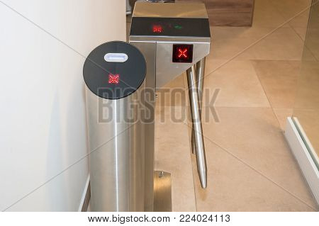 Automatic access control ticket barrier. Ticket scanner. Close up. poster