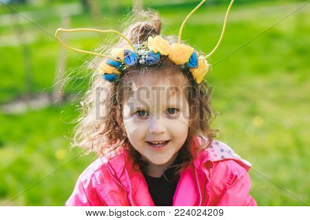 Kids in bunny ears and rabbit costume. Toddler kid play outdoor.