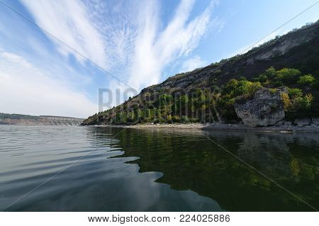 river landscape. Photo from the boat. A lot of sky. Blue sky with clouds. Greenish waves. Summer. the Dniester River