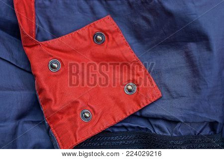 red blue fabric texture with iron rivets