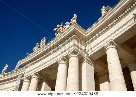 Fragment of the Bernini colonnade against the blue sky in the Vatican