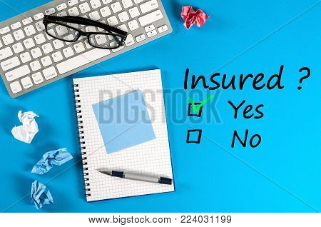 Family life, travel, car and haelth insurance, services and supporting concepts. Businessman or insurance agent workplace with question - Insured. Yes or no.
