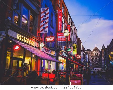 Dublin, Ireland - January 27th, 2018: Anne Lane In Dublin City Centre At Dusk With Pubs, Shops And R