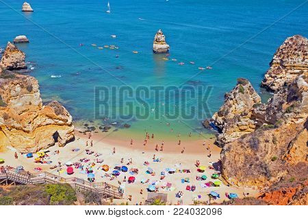 Tourism in the Algarve at Praia D'Ana in Lagos Portugal