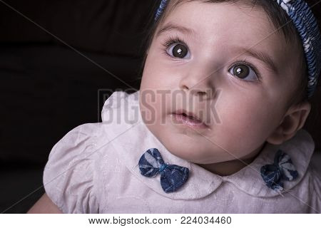 Close-up portrait of a 5 months old baby girl