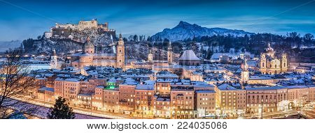 Panoramic view of the historic city of Salzburg with Hohensalzburg Fortress in winter at blue hour, Salzburger Land, Austria