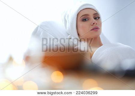 Young woman lying on a massage table,relaxing. Woman. Spa salon