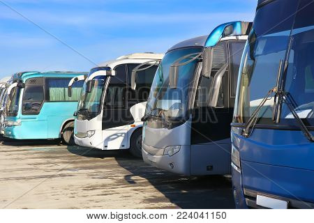 big tourist buses coach on parking photo .