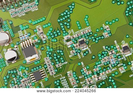 Close up of a printed green CD-ROM circuit board