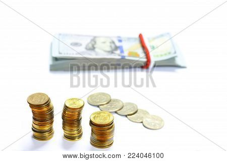 US Dollar bills banknotes with white background. Money Coins.