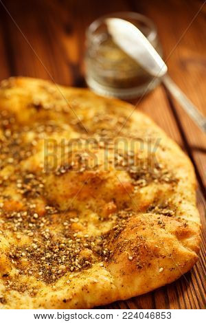 Zaatar spice mix with naan bread - traditional Middle Eastern blend made with thyme, sesame seeds, salt, sumac, oregano, cumin, fennel seeds and marjoram