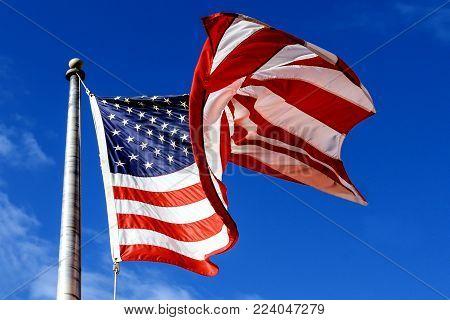 USA Flag over blue sky waving american flag over the blue sky