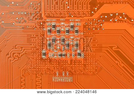 Close up of printed red computer circuit board