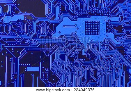 Close up of printed blue computer circuit board