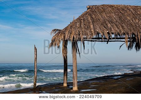 Thatched surfer shack at Windansea Beach in La Jolla, California.
