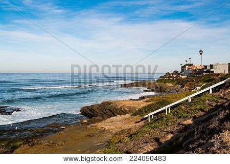 Windansea Beach in La Jolla, California with white staircase leading to beach.