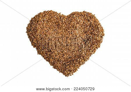 Diet of a healthy diet. Raw linen seeds flaxseed heart formed on a white background.