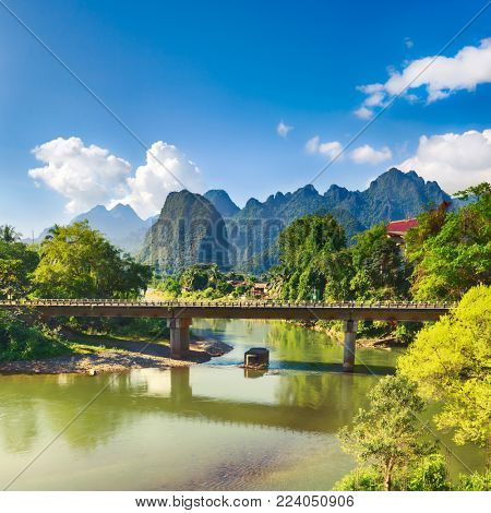 Amazing landscape of Nam Song river among mountains. Bridge on the foreground. Pha Tang, Vang Vieng district, Laos.