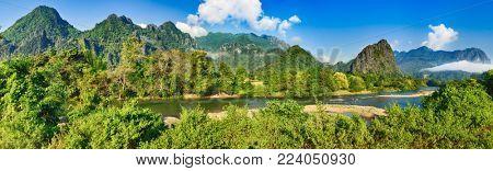 Amazing landscape of Nam Song river among mountains. Vang Vieng. Laos panorama.