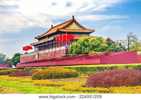 BEIJING, CHINA - NOVEMBER 13, 2017 Mao Tse Tung Tiananmen Gate Gugong Forbidden City Palace Wall Beijing China.  Chinese Sayings on Gate Are