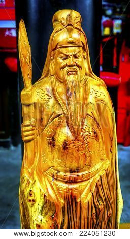 Chinese Replica Wooden Guan Yu Decoration Panjuan Flea Market  Decorations Beijing China.  Guan Yu is a hero from the Romance of The Three Kingdoms and is considered by some as a Chinese god.  Panjuan Flea Curio market has many fakes, replicas and copies